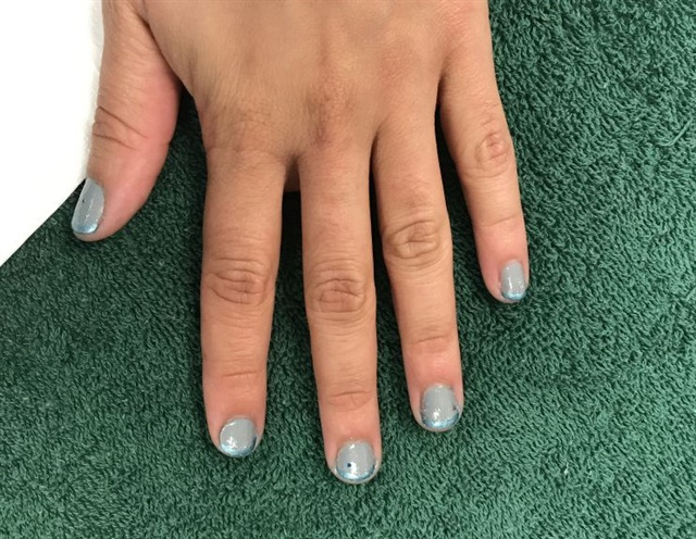 <p>I put a twist on my classic French manicure.</p>