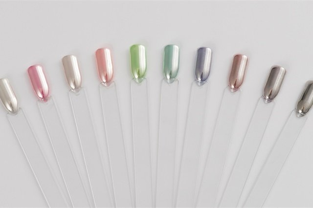 Experiment By Applying Different Gel II Polish Colors Under The Chrome Powder To Create A Rainbow Of Colored Nails