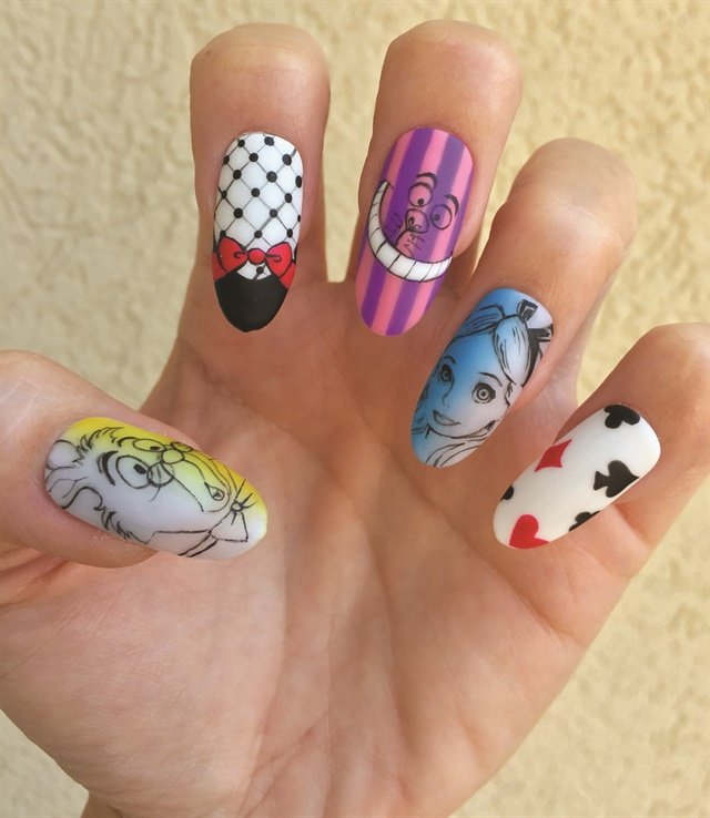 Garcia's salon modifed Alice in Wonderland nails.