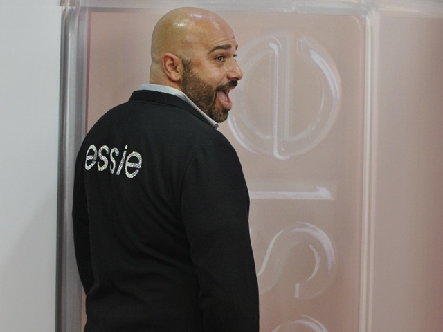<p>Trunzo was always a staple at the Essie booth, sporting nail art and Essie gear.</p>