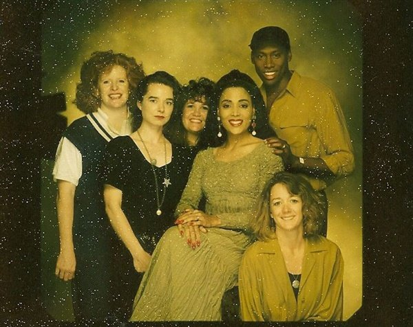 <p>Flo-Jo and her husband Al (above her left shoulder) at the NAILS cover shoot.</p>