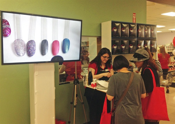 <p>CND Education Ambassador Heather Davis shows attendees how to use Brisa Gel to create dimensional summer nail styles.</p>