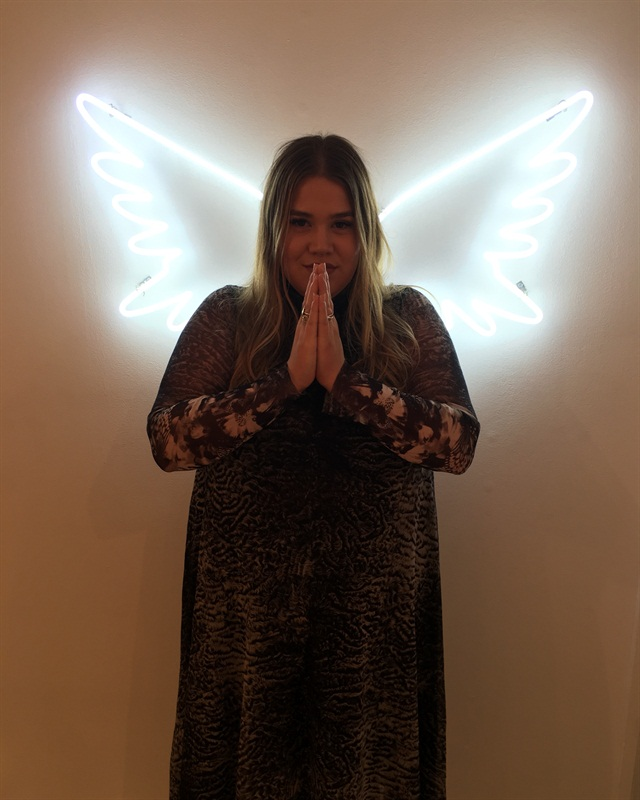 The Melody Ehsani store features wings where people can pose and tag #wingedatme