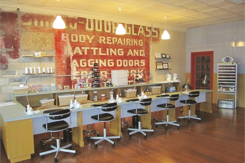 SPAtaneity's manicure bar is comprised of five stations custom built to maximize space and give the salon a modern, urban-chic feel. The original brick and hand-painted signs that mark the location's past as an auto repair shop peek through.