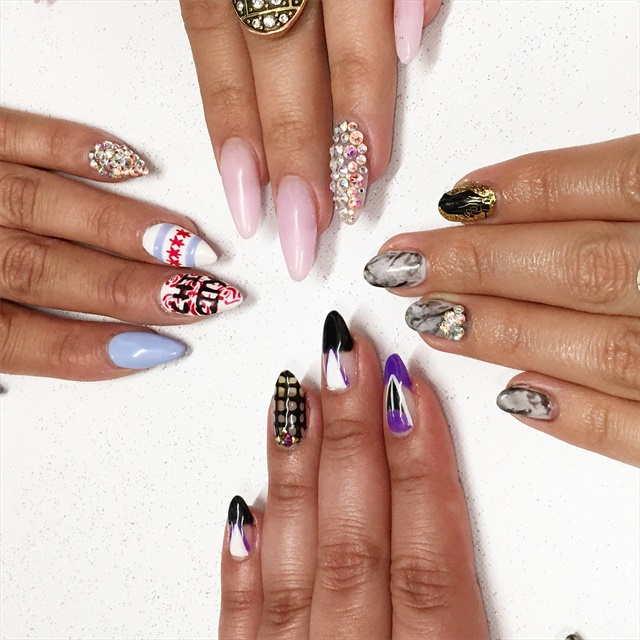 <p>Nail art group shot. Clockwise from top: Ellegra Davis, Beth Livesay, Sigourney Nunez, and Nicole Rios</p>