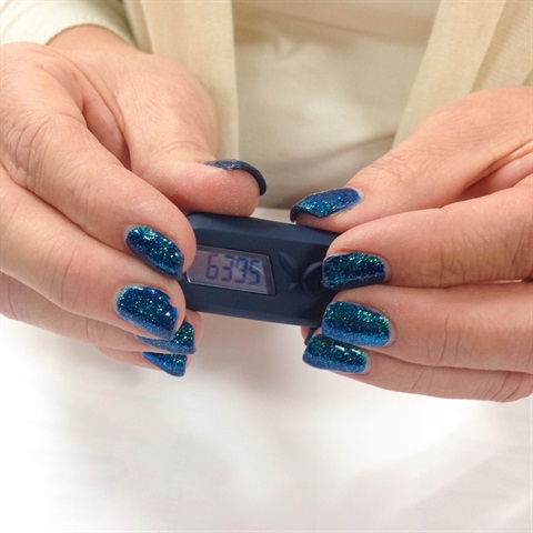 <p>Editor Erika shows off her  pedometer</p>