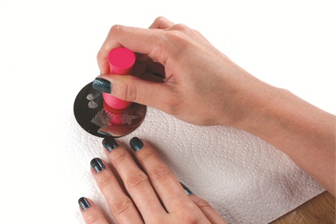 BundleMonster stamps are applied to nails in a few simple steps.
