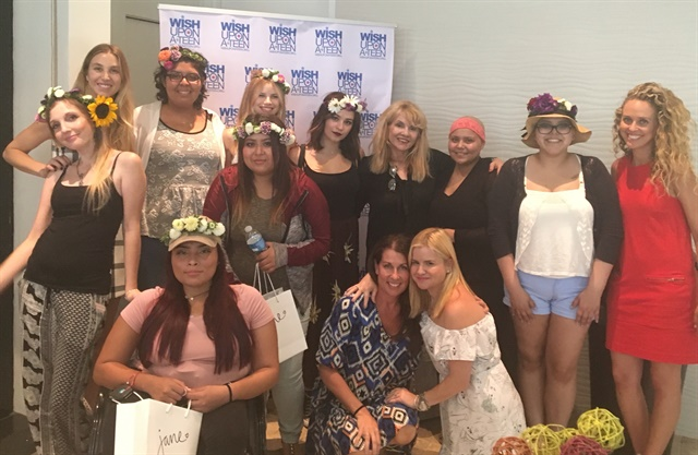 Celebrating their spa day, the attendees pose with celebrity guests.