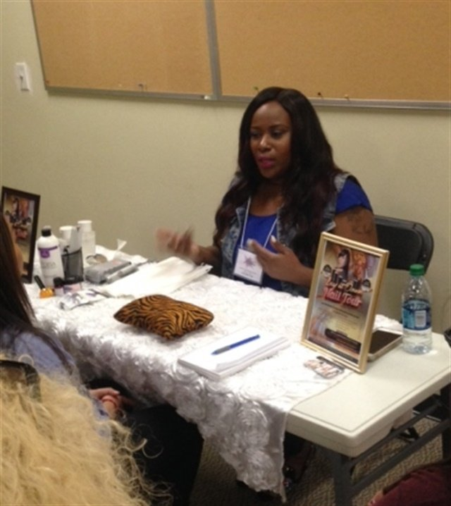 <p>Temeka Jackson demos acrylic application with INM products.</p>
