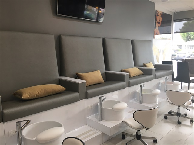 """<p>Furniture was designed by <a href=""""http://www.nailsmag.com/article/112419/show-and-tell-with-a-salon-design-pro"""">Michele Pelafas</a></p>"""