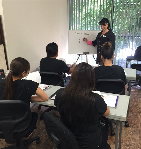 <p>Jessica Taylor leads a class of aspiring nail techs.</p>