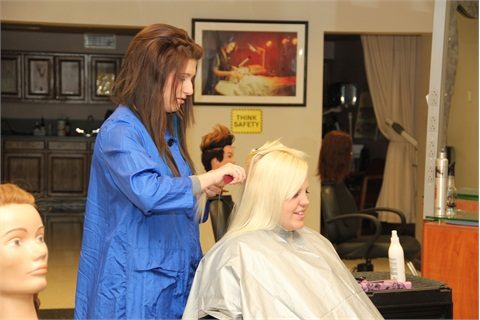 Students Ty Dutton and Caitlin Olmstead work in the cosmetology room.