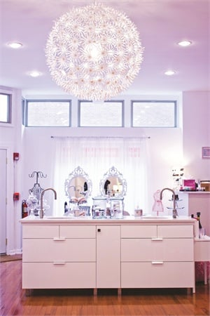 <p>Commenting on Lacquer Lounge's color scheme, owner Lisa McElhone says the pinks bring out the salon's girly flavor while the whites evoke cleanliness.</p>