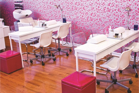 <p>Clients can receive manicures priced anywhere from $10 to $45, depending on the service. Clients sit at nail bars perched in front of color-popping wallpaper.</p>