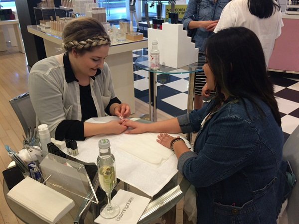 Manicurist to the stars, Kait Mosh, preps and polishes Sig's nails using JINsoon.