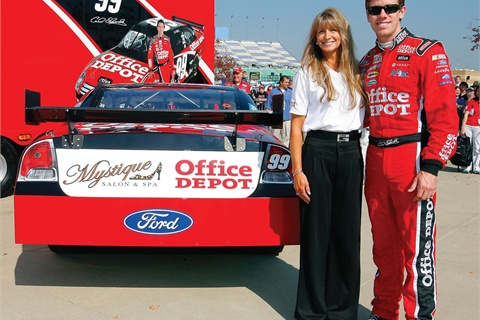 <p>NASCAR star Carl Edwards and salon owner Julie Catalano stand next to her company's logo on the No.99 Office Depot Ford.</p>