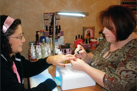 <p>Christine McGrath gets acrylic clients interested in gels by putting a gel sealer over their nails.</p>