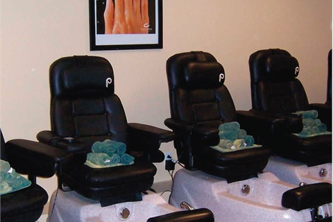 <p>There are two pedicure rooms at the school's Tuscany Day Spa. One with nine pedi thrones (shown here), and a smaller room with five.</p>