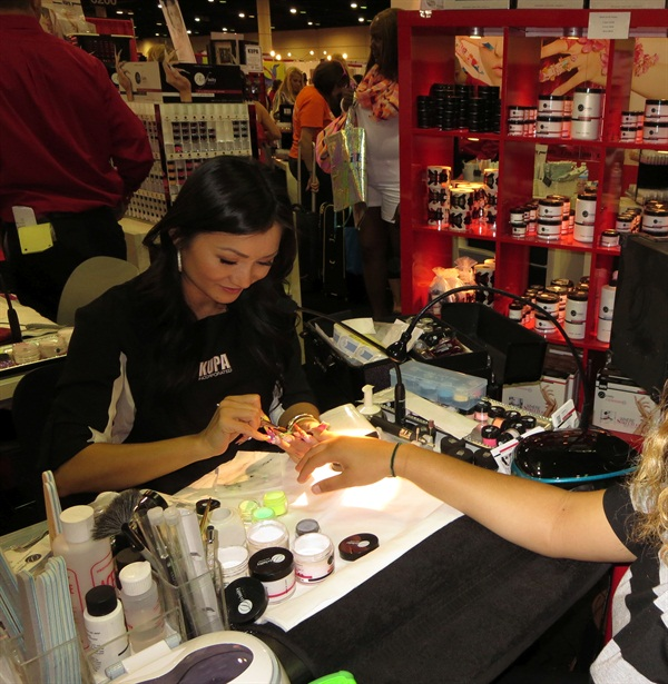 <p>A Kupa nail tech demonstrates at Premiere Orlando 2014.</p>