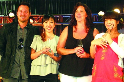 <p>In this photo from 2009, Tom poses with the winners of the Pink and White competition and Nail Expo 2009.</p>