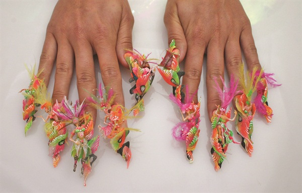 <p>Elena Zenina of Russia captured the spirit of Carnival with these 3-D fantasy nails that earned her a first-place win in the 3-D category, master level.</p>