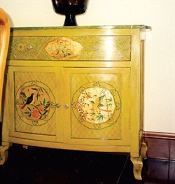 <p>She also decorates furniture as well as walls.</p>