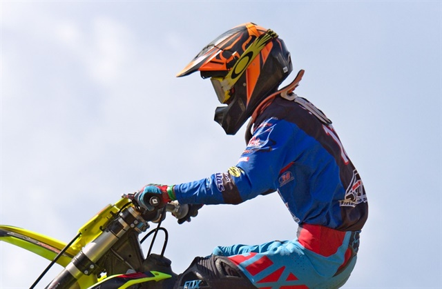 Holley Dowell Delorme repaired the paint on a dirt bike helmet.