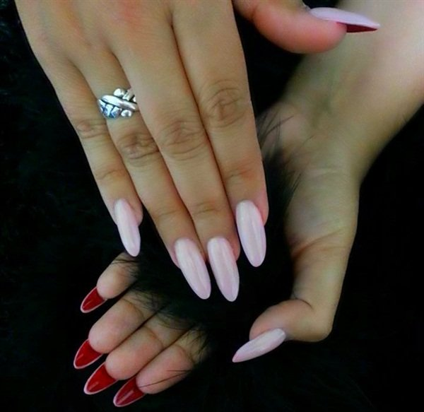 <p>These nails by Triana Ramirez of San Pedro, Calif., actually reflect the style Jolie wore in the film, with pale natural color and red underneath. (Instagram: @trianails)</p>