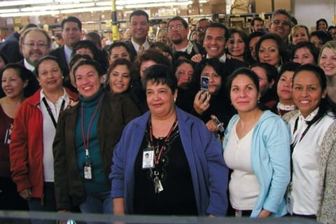 <p>Villaraigosa poses with some of OPI's 400 employees.</p>