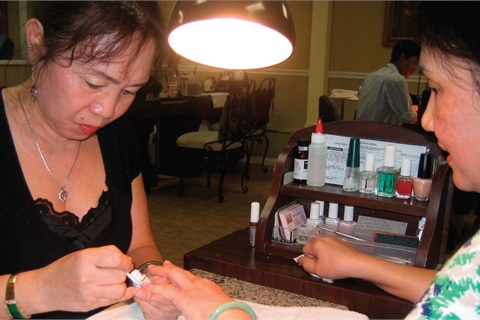 <p>Skye Wee-Tom of Modern Nail in Atlanta, charges $5 for her UV top coat applications.</p>