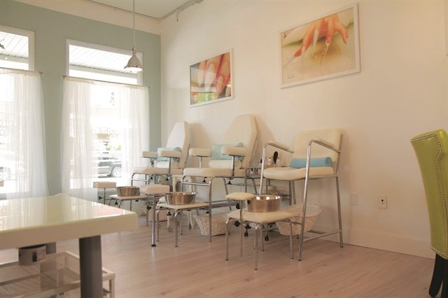 "Suzie Moskal's decorating begins when she looks at her space through the ""client's eye."" She looked inside her salon's two front windows and designed the soft, comfortable pedicure area with fun, retro-looking chairs in faux leather and chrome."