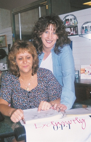 <p>Natural Nails owner Melody Umbs-Lloyd (right) keeps staff members on top of their game by frequently trying new product lines and attending continuing education classes.</p>