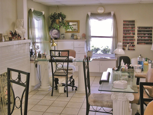 <p>It's hard to see the wet buckled walls in the salon's interior.</p>