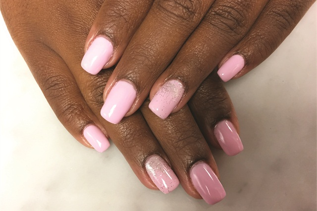 Phoenix typically works on natural nails with three-free polish but got to apply gel-polish on a Harmony Nail Studio client.