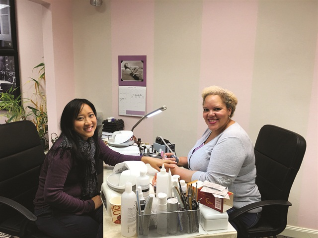 <p>Oung (left) and Phoenix at Harmony Nail Studio</p>