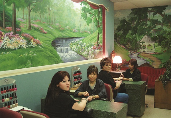<p>Nail techs Alice and Sue, and the new mural</p>