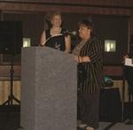 Nancy Lawrence accepting her award in 1999