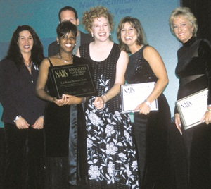 <p>Brown-Glenn (second from left) accepting her award in 1999</p>