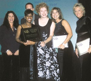 Brown-Glenn (second from left) accepting her award in 1999