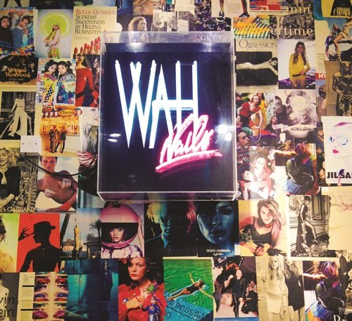 A collaged wall featuring cutouts from fashion magazines adorn the nail salon providing major eye candy and trendy inspiration.