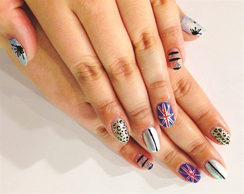 <p>Wah Girl Chiizii hand painted a Union Jack accent and paired it with a prismatic set of classic and popular nail art designs. </p>