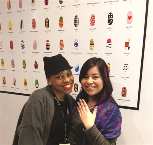 <p> That's me (right) and Wah Girl Chiizzii. Check out the size of the nail art menu!</p>