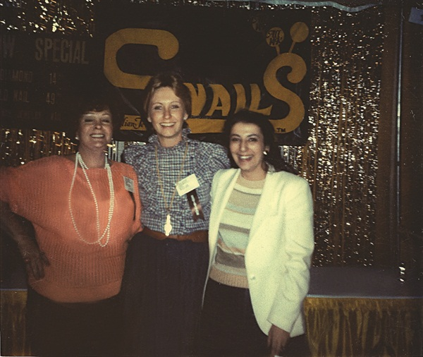 <p>Way back then ... Snails president Marlene Sortino (center) wanted a 14K gold nail charm for her own nails, but none existed, so she had one made for herself. This is Marlene (center) at her very first tradeshow in Long Beach.</p>