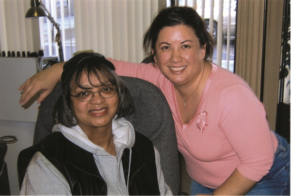 <p>Maeling Parrish (right) with her client Lonnie Newman</p>