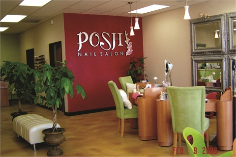 <p>Posh Nail Salon features a cheerful pink and lime green color scheme.</p>