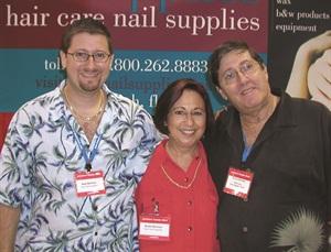<p>Alex Berman (left) with his parents, Bobbi and Wayne Berman, founders of the company</p>