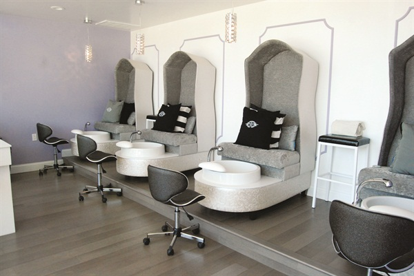 <p>Four chic custom and cozy pipeless pedicure chairs are equipped with a subtle massage and heat feature and extra deep bowls. Peep the custom black glitter chairs nail techs use. </p>