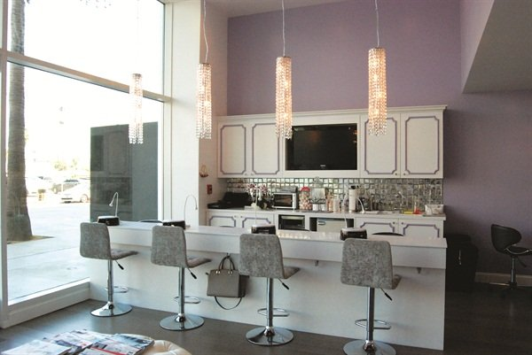 The mini nail bar includes four custom stools facing the boulevard for a peek at Hollywood's busy street life.