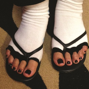 <p>Eva Jenkins made her own toeless socks to offer to her pedicure clients.</p>