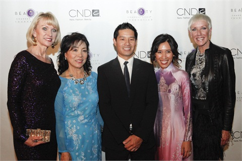 Beauty Changes Lives president Lynelle Lynch, Thuan Le, Advance Beauty College owners Tam and Linh Nguyen, and CND co-founder Jan Arnold.